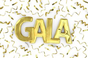"""3D render of gold metallic word """"Gala"""" on a plain white background surrounded by confetti streamers."""